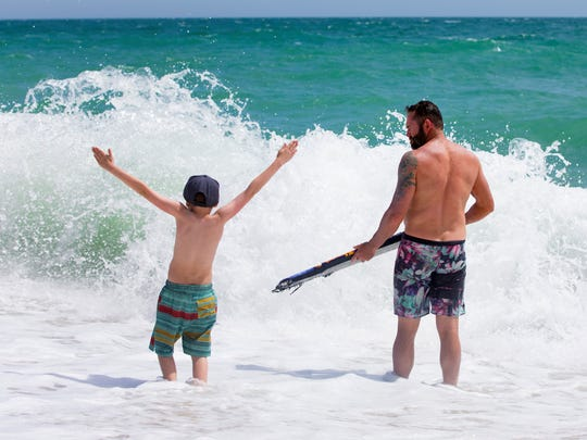 Maverick McCall, 9, left, and  his father Shane McCall,