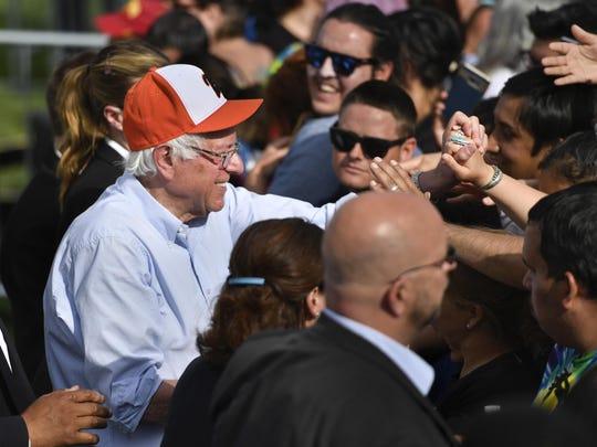 Bernie Sanders shakes hands Sunday, May 29, 2016 after speaking at Groppetti Community Stadium in Visalia.