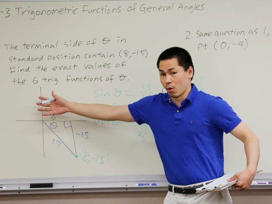 """While a high school student, Minshen Ho """"started to realize I was helping a lot of other students with their math, and I thought I was pretty good at math myself."""" Here he leads an algebra II class at West Lafayette High School. i"""