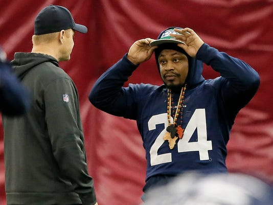 Seattle Seahawks' Marshawn Lynch adjusts his cap during a team practice for NFL Super Bowl XLIX football game, Friday, Jan. 30, 2015, in Tempe, Ariz. The Seahawks play the New England Patriots in Super Bowl XLIX on Sunday, Feb. 1, 2015. (AP Photo/Matt York)