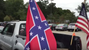 The Confederate flag flies on a pick up truck.