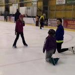 Avery Bandel, right, president of the Great Falls Figure Skating Club, provides instruction to kids attending the Community Day event at the Great Falls IcePlex in November.