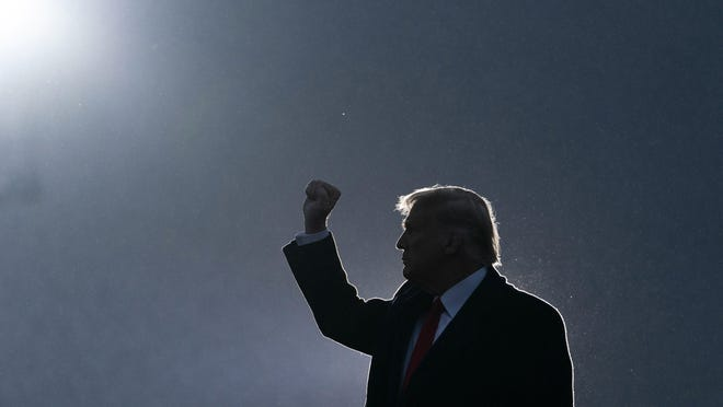 President Donald Trump pumps his fist as he departs after speaking at a campaign rally at Altoona-Blair County Airport, Monday in Martinsburg, Pa.