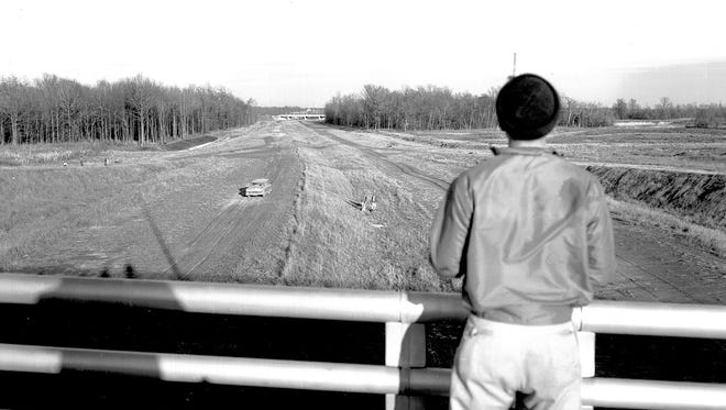 READY FOR PAVING - Paving of a stretch of the southeast circumferential expressway is expected to begin as soon as alignment work is completed. John A. Lloyd of the Tennessee Highway Department is looking east toward Mt. Moriah from Perkins in early March 1962.