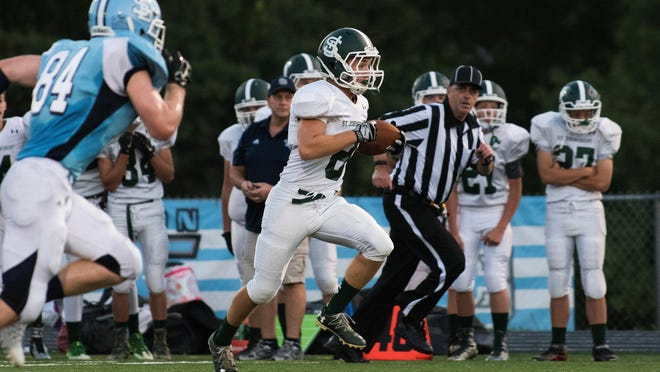 St. Johnsbury's Shane Alercio (8) runs with the ball during the high school football game between the St. Johnsbury Hilltoppers and the South Burlington Rebels at South Burlington high school on Friday night September 2, 2016 in South Burlington.