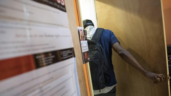 In this Tuesday, July 3, 2018, photo, a member enters the bathroom at VOCAL-NY headquarters in the Brooklyn borough of New York. VOCAL-NY runs a needle exchange and harm reduction services, as well as overdose prevention and other services for people who use drugs. (AP Photo/Mary Altaffer)