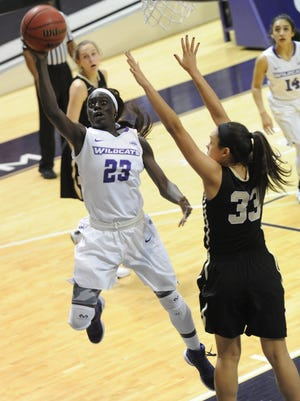 ACU's Suzzy Dimba (23) drives to the basket as Harding's Sydnie Jones defends. The Wildcats beat Harding 74-62 on Saturday, Dec. 10, 2016 at Moody Coliseum.