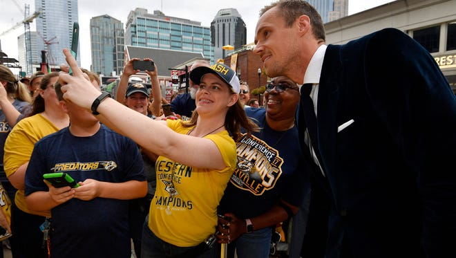 Predators goaltender Pekka Rinne poses for a photo on the Gold Walk before the home opener Oct. 9.
