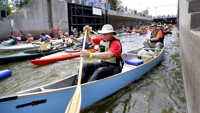 Canoeists and kayakers exit the Menasha lock when it was open to traffic. The lock has been closed since the 2015 discovery of round gobies below the Neenah dam.