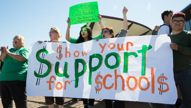 Teachers, students and representatives from the National Education Association gathered outside Las Cruces High School to demonstrate against further budget cuts by the state. Friday, March 17, 2017.