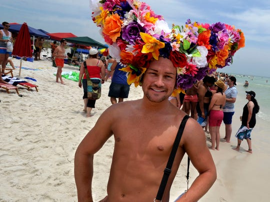 Josh Richardson walks along the beach at Park East on during a previous Memorial Weekend celebration. Pensacola Beach has become a annual destination for the LGBT community for a weekend full of events.