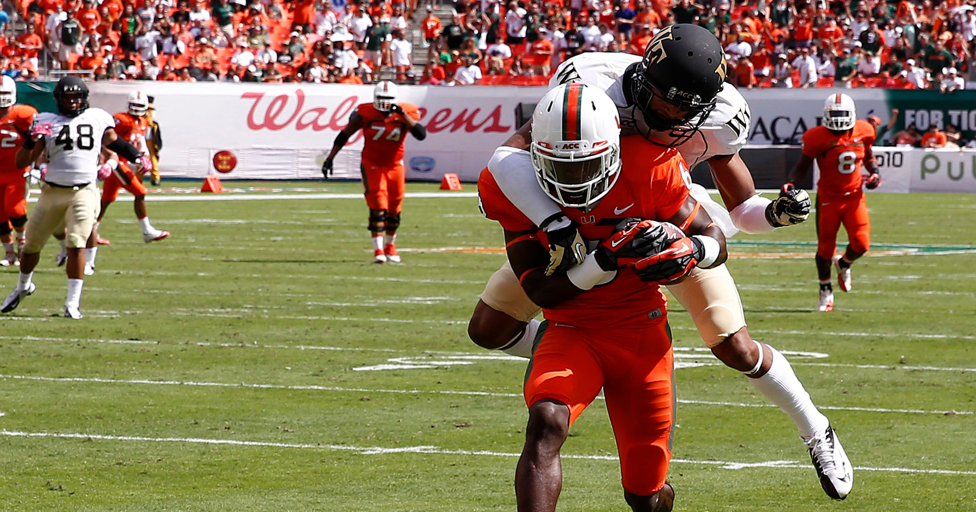 01d95cd52 No. 6 Miami rallies behind Duke Johnson to clip Wake Forest