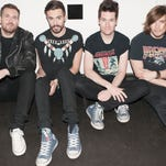 """Will Farquarson, from left, Kyle Simmons, Dan Smith and Chris """"Woody"""" Wood of Bastille."""