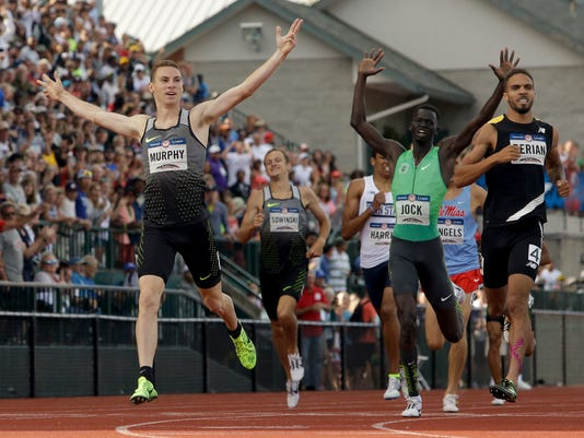 Clayton Murphy, left, winner, Boris Berian, right, in second place, and Charles Jock in third place, cross the finish line in men's 800-meter final at the U.S. Olympic Track and Field Trials, Monday, July 4, 2016, in Eugene Ore.(AP Photo/Marcio Jose Sanchez)