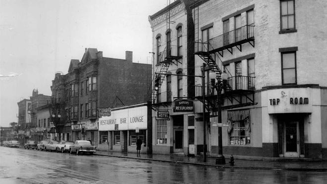 Business  on Clinton Ave. will be raised to make way for Inner Loop. (Staff photo) Tu 3/8/1957