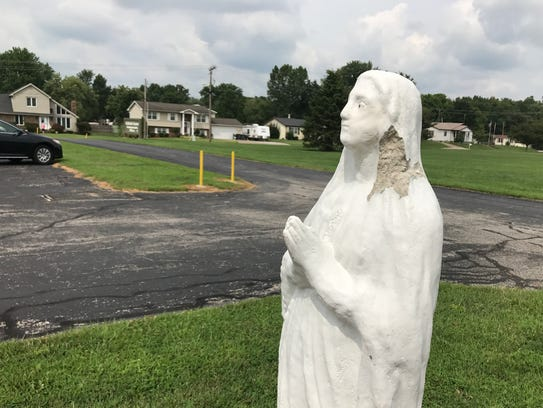 Damage to a statue of the Virgin Mary knocked down