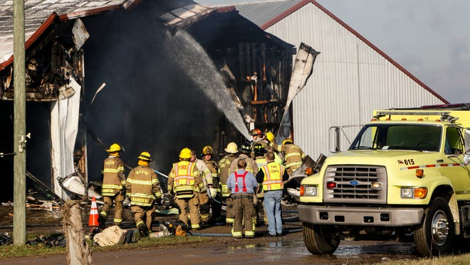 First responders work to put out a fire at Car Min-Vu Farm, a dairy farm in Leroy Township, Thursday, Nov. 30, 2017.  Responders from Williamston, Leroy Twp., the Ingham County Sheriff's Dept., and Mason Fire Dept. responded.  No people or animals were injured, Chad Minnis, one of the farm owners said.