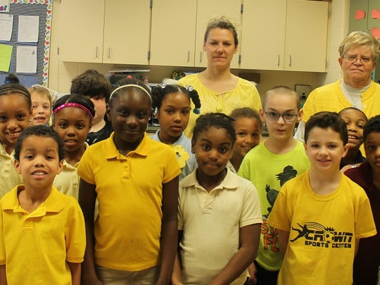 This April 1, 2015 photo is of Linda Walston's second grade class at Carter G. Woodson Elementary School in Crisfield. Students wore the color yellow in memory of Crisfield High School student Andrea Nichole Joyner, 15, who died March 27 in a vehicle accident. Yellow was Andrea's favorite color, said school officials.