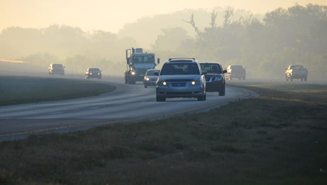 Traffic heading west on 520 early Friday morning. Early Friday morning the Beachline was temporarily closed from 520 to I-95 due to smoke from surrounding brush fires.