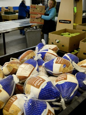 Green Bay Packers defensive backs Tramon Williams and Davon House, working with Life Church of Lawrence, have donated 1,500 turkeys to Paul's Pantry for families in need.