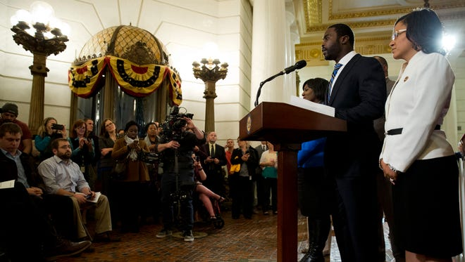 Pittsburgh Steelers quarterback Mike Vick, at podium, speak during a news conference Tuesday, Dec. 8, 2015, at the state Capitol in Harrisburg, Pa. Vick is lobbing Pennsylvania legislators on a bill that would help protect pets left in hot cars. Vick was a star quarterback for the NFL's Atlanta Falcons when he pleaded guilty in 2007 to being part of a dogfighting ring and ended up serving 21 months in prison.