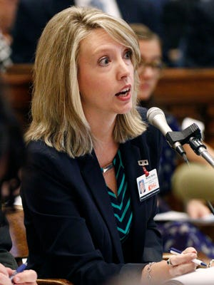 Wendy Bailey, director of outreach and planning with the Mississippi Department of Mental Health, answers lawmakers questions during a hearing before the Legislature's working health care group Wednesday, Sept. 7, 2016, at the Capitol in Jackson, Miss.