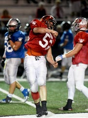Seth Schwab, of Ridgewood, celebrates a fourth-quarter sack during the West's 20-10 win in the Times Reporter Charities All-Star Game on Friday at Woody Hayes Quaker Stadium in New Philadelphia.