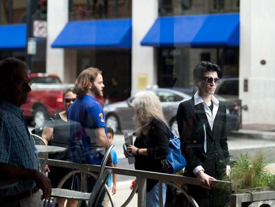 People wait along Gay St. to attend Jupiter Entertainment's