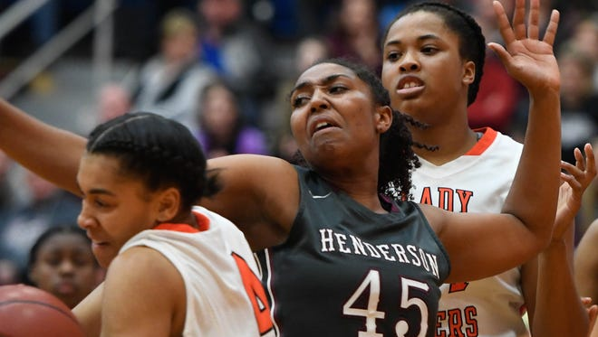Henderson's Alisha Owens battles for a rebound with Hopkinsville's Jaliyah Grubbs (left) and Zakyra Stallworth as Henderson County plays Hopkinsville in the second Second Region semifinal game in Mortons Gap Friday, March 3, 2017.