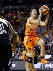 Western Conference's Sue Bird, of the Seattle Storm, drives the lane before passing off against the Eastern Conference in the first half of the WNBA All-Star basketball game Saturday, July 22, 2017, in Seattle. (AP Photo/Elaine Thompson)