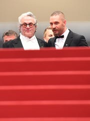 George Miller (L) and US actor Tom Hardy prepare to