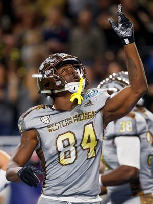 Western Michigan Broncos wide receiver Corey Davis (84) celebrates his touchdown in the first half against the Ohio Bobcats at Ford Field.