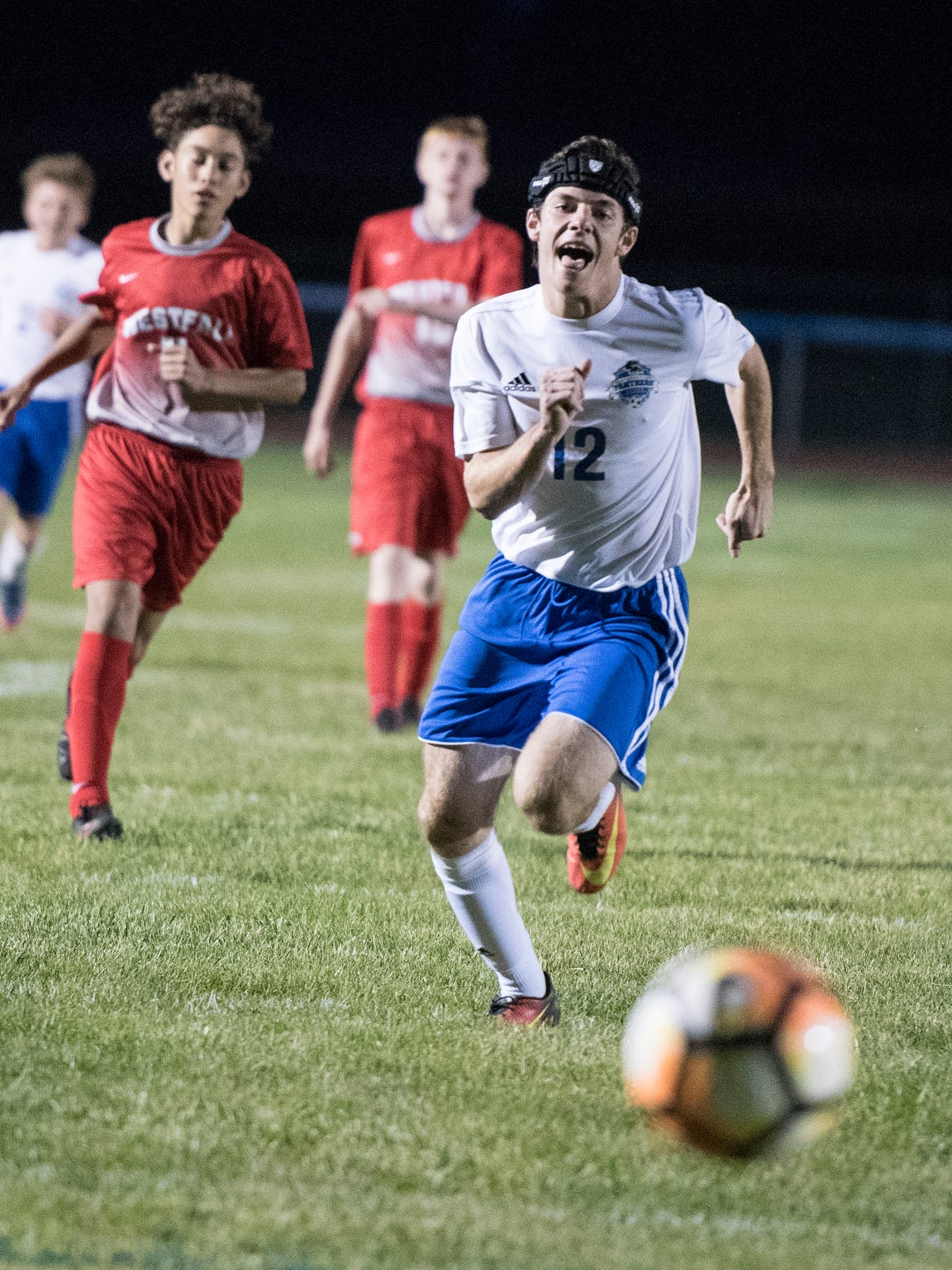 Lucas Meininger chases after a free ball during his