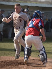 Unioto's Ryan Burns crosses home plate and scores a run for Unioto Friday night at Zane Trace High School.