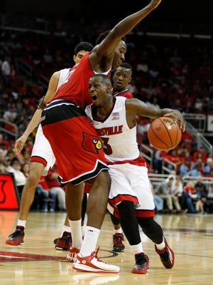 Louisville's Chris Jones drives arounda Red team member