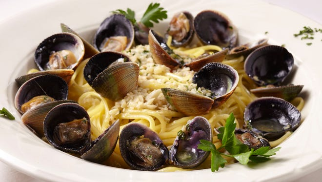 In this photo, Linguini with clams can be seen. After taking its standard summer break, Johnny Costa's Ristorante reopens Friday night, September 4, for its 40th season.