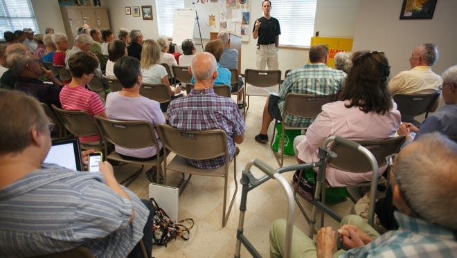 Neuropsychologist Dr. Timothy Kockler, center, talks about proper nutrition and answers questions for the members of an Alzheimer's Disease support group Tuesday, Sep. 23, 2014 at the St. George Senior Center.