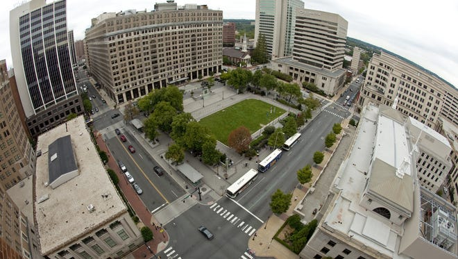 Rodney Square in downtown Wilmington, surrounded by office towers and businesses, is shown. The city's economy is the topic of a mayoral debate planned Tuesday.