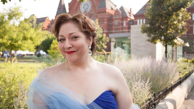 Soprano Christine Goerke, the star of Cincinnati Opera's Fidelio, in Washington Park just before her performance in the Opera in the Park concert last Sunday..