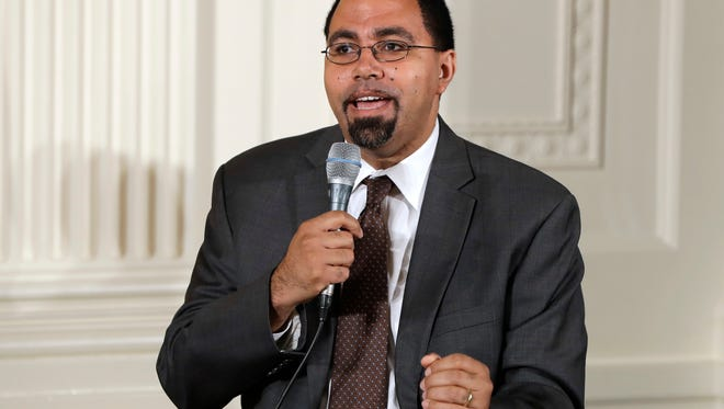 FILE - In this July 19, 2016, file photo, Education Secretary John B. King, Jr., speaks on a panel with first lady Michelle Obama to college-bound students participating in the Reach Higher initiative's third annual Beating the Odds event in the East Room of the White House in Washington. (AP Photo/Jacquelyn Martin, File)