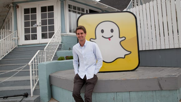 Snapchat co-founder Evan Spiegel in front of the old
