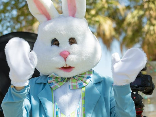 The Easter Bunny, who was available for pictures, waves