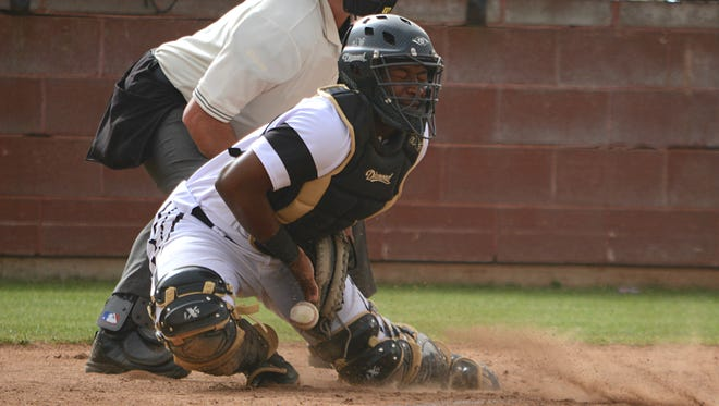 Abilene High catcher Terrell Franklin blocks a ball in the dirt during the Eagles' 7-4 win over Lubbock Christian on Friday at Blackburn Field.
