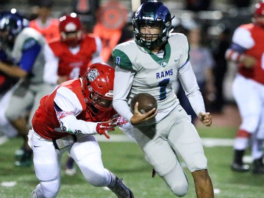 Montwood senior quarterback Andrew Fernandez slides left on a keeper play that got the ball to the one yard line of the Socorro Bulldogs Thursday night at the Socorro Activities Complex. Fernandez kept it on the next play for a score.
