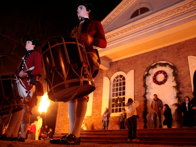 The Colonial Williamsburg Fife & Drum Corps play in front of the Courthouse.