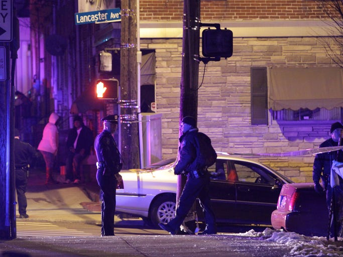 Wilmington police investigate at the scene of a shooting reported shortly after 12:30 a.m. Thursday at North Franklin Street and Lancaster Avenue.