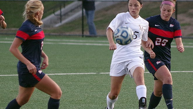 Halie Parker, in white, returned to the Millersville women's soccer team from an injury and helped the Marauders win three straight games.