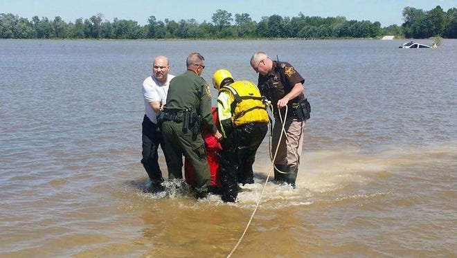 Indiana agencies work together to rescue a Bloomington man whose vehicle had been swept off a road by flood waters Sunday in Jackson County.