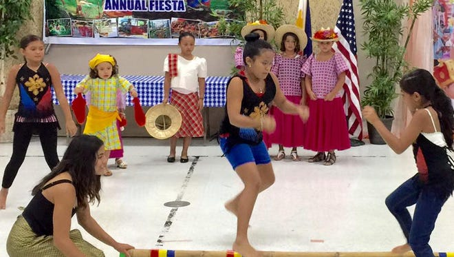 The Bayanihan Association hosts a Philippine cultural event with traditional dances and music.