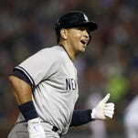 The New York Yankees' Alex Rodriguez rounds third on his way home after hitting a solo home run in the sixth inning Monday.